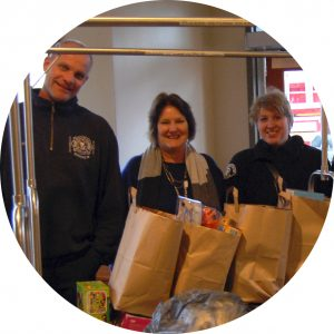 Volunteers bring bagged donated goods to the House