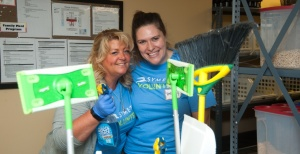 Work group volunteers pose with cleaning supplies