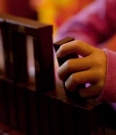 Child's hands play with blocks