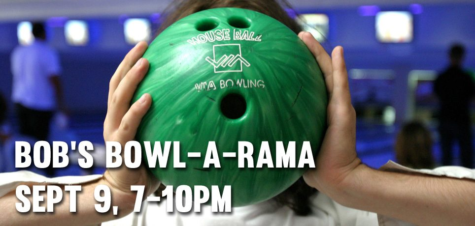 Woman holds bowling ball in front of her head