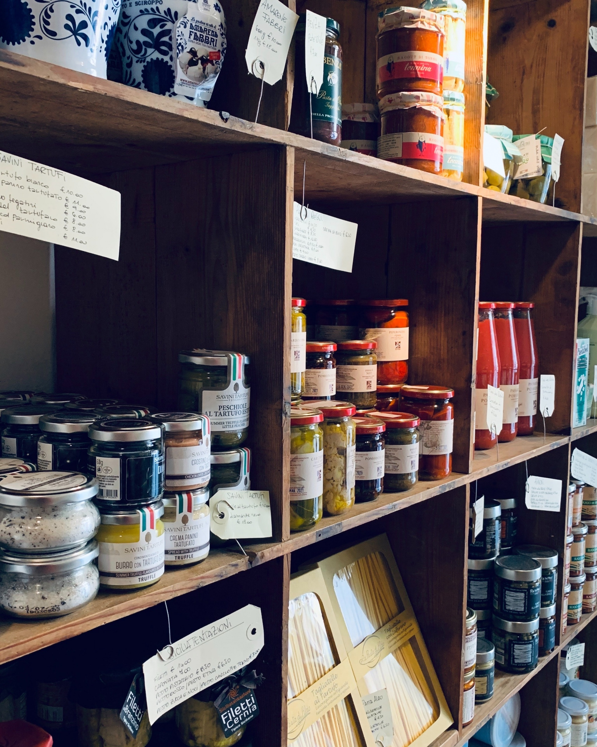 A stocked pantry full of canned goods.